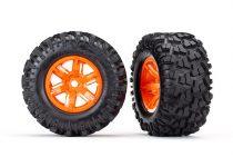 Traxxas  Tires & wheels, assembled, glued (X-Maxx® orange wheels, Maxx® AT tires, foam inserts) (left & right) (2)